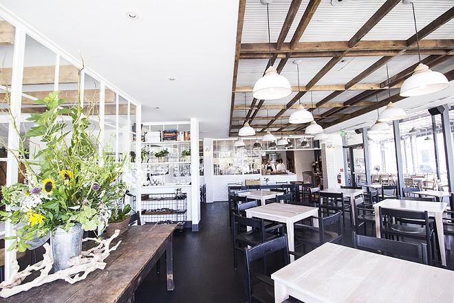 Vicia's striking dining room has a warmth despite its black and white color scheme. - MABEL SUEN