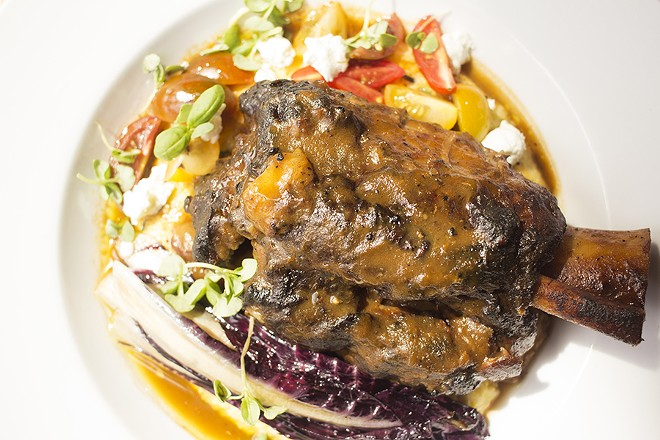 Pork osso bucco with herb and goat cheese polenta, treviso and heirloom tomatoes. - MABEL SUEN