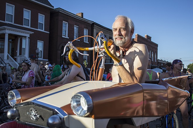 "For a ""naked"" ride, costumes can get elaborate. Charlie Wolters modified his own bike to look like a car. - SARA BANNOURA"