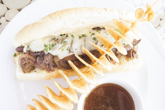 Braised chuck roast sits on a Balkan-style hoagie with caramelized mushroom and onions and smoked provolone. - PHOTO BY MABEL SUEN