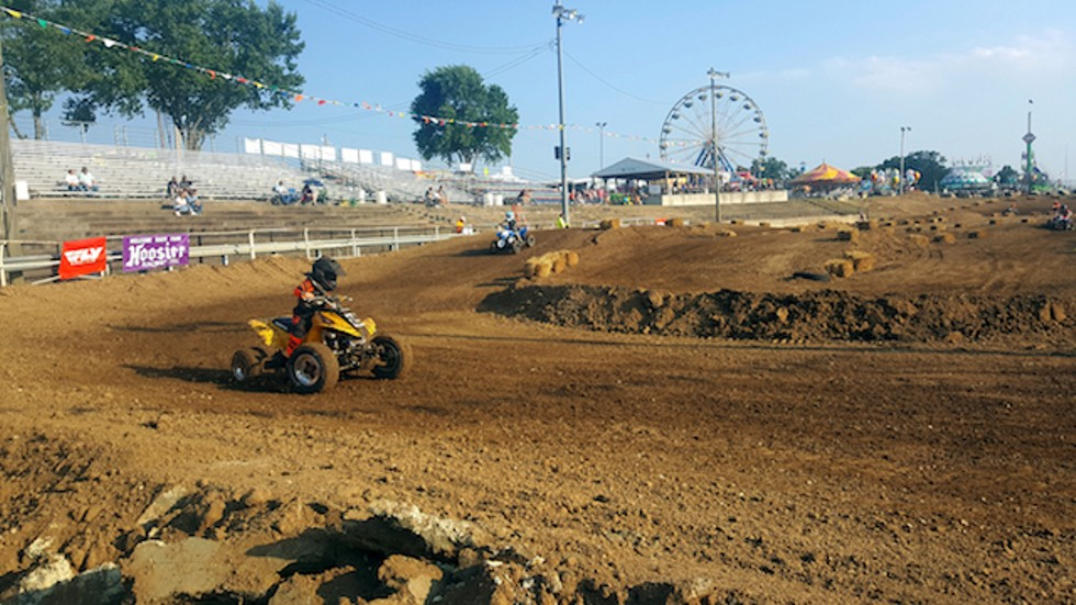 A young racer tears around the track at the Jeffco Fair. - PHOTO BY DANNY WICENTOWSKI