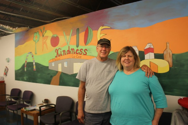 """Ron Bickerstaff (left) and the Reverend Marsha Brown run the food pantry. """"This is Ron's dream and I've had this dream too,"""" Brown says through tears. """"We've always wanted to do something that matters."""" - PHOTO BY SABRINA MEDLER"""
