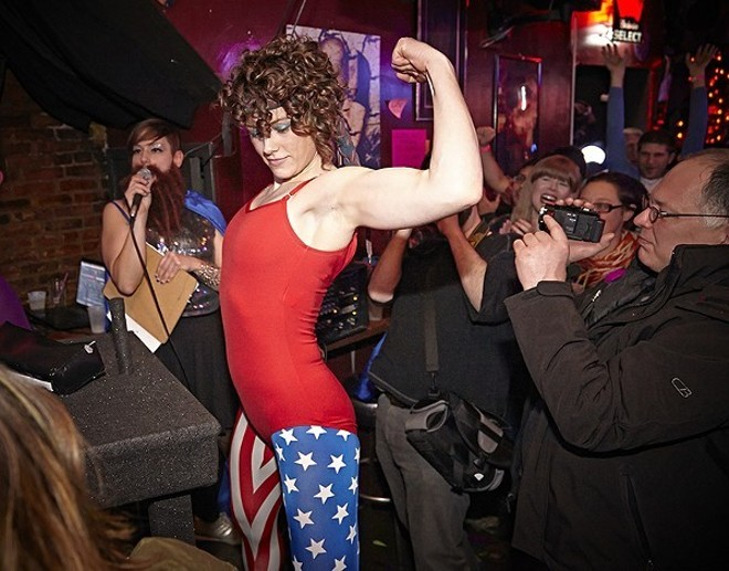 The mighty St. Louis Lady Arm Wrestlers engage in battle on Saturday. - STEVE TRUESDELL