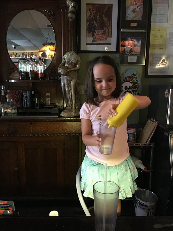 A young bartender at the Waiting Room shows she has the right stuff. - PHOTO BY SHANNON NICHOLS