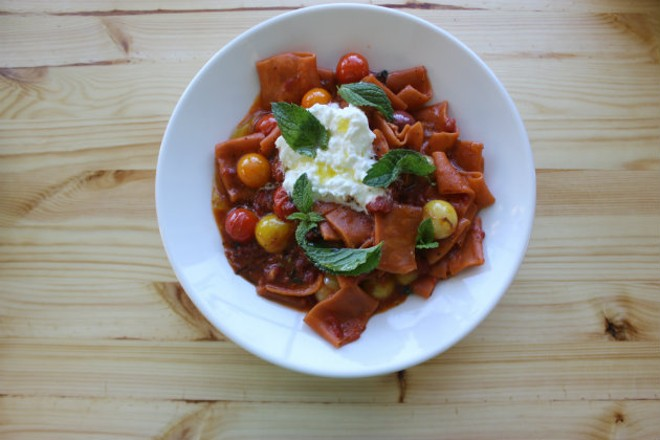 Handmade pasta with tomatoes, fresh cheese and mint. - CHERYL BAEHR