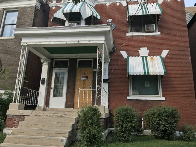 The door of 3925 Greer Avenue was boarded up went tenants came home on Monday. - IMAGE VIA ARCHCITY DEFENDERS