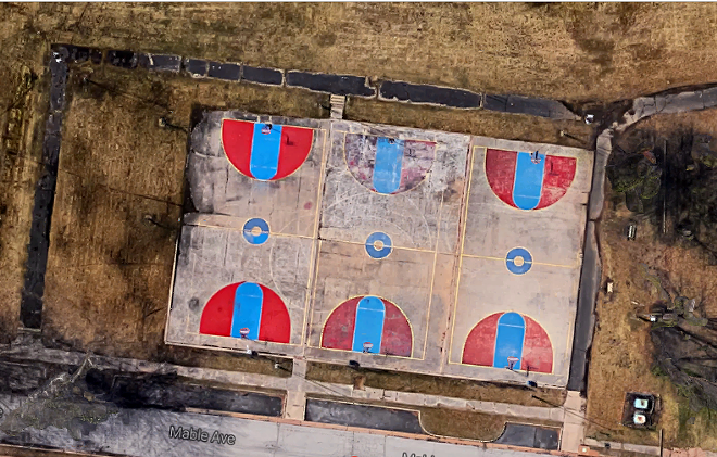 This photo shows the courts before their transformation. Just below is the finished artwork. - COURTESY OF DANIEL PETERSON