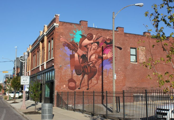 The mural on Sauce on the Side building has a food theme. - PHOTO BY SARAH FENSKE
