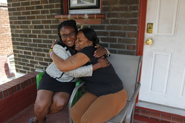 Rhonda Tunstall, right, hugs attorney Kalila Jackson, who helped her through what she says was a frightening ordeal. - PHOTO BY KATIE HAYES