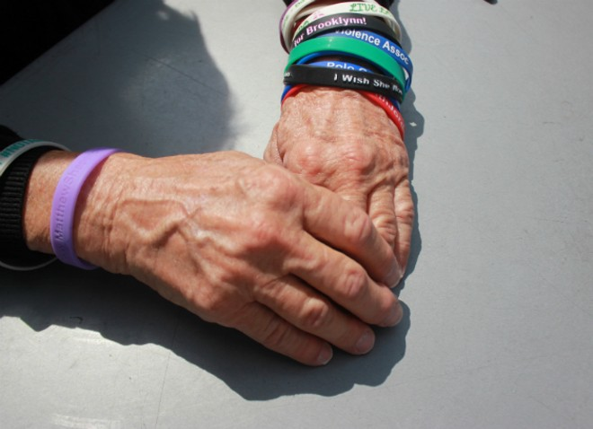 Pat Maisch wears bracelets to remember victims of gun violence. - PHOTO BY DOYLE MURPHY