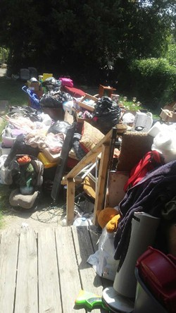 Tunstall's possessions were thrown into her landlord's backyard. - COURTESY OF RHONDA TUNSTALL