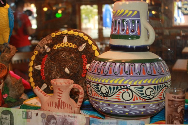 Authentic Mexican artwork decorates the dining room. - CHERYL BAEHR