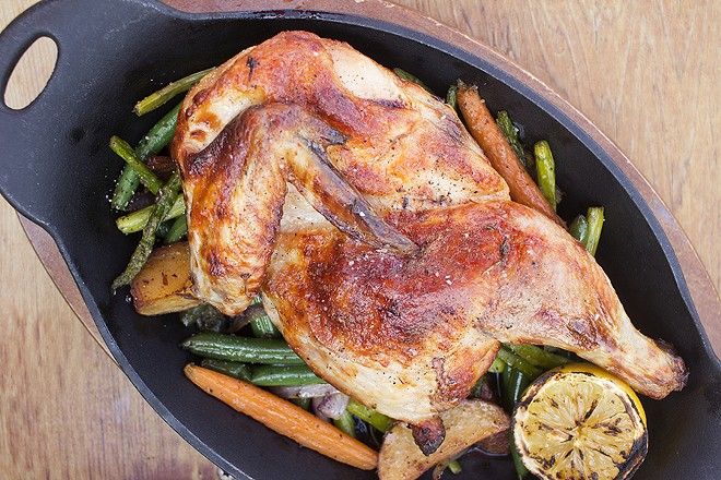The brathendl is a classic German presentation of a half spit-roasted chicken with seasoned veggies. - PHOTO BY MABEL SUEN