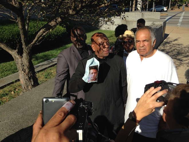 Anthony Shahid and other activists react to the verdict. - PHOTO BY DOYLE MURPHY