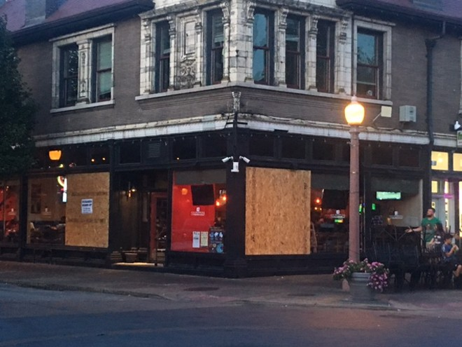 Culpepper's had its windows broken during protests on the night of September 15, 2017. - PHOTO BY CATHLEEN CRISWELL