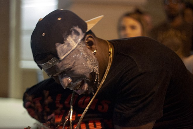 Bystanders treated a man affected by police pepper-spraying by pouring milk on his face. - PHOTO BY DANNY WICENTOWSKI