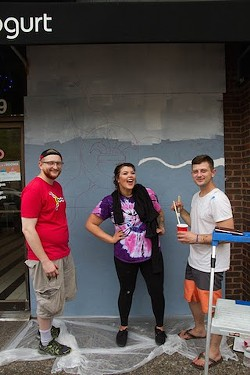 Artists Mark Ostroot, Nicole High and Layden Walley work on the plywood covering Fro Yo. - COURTESY OF PAINTING FOR PEACE IN FERGUSON, A CHILDREN'S BOOK