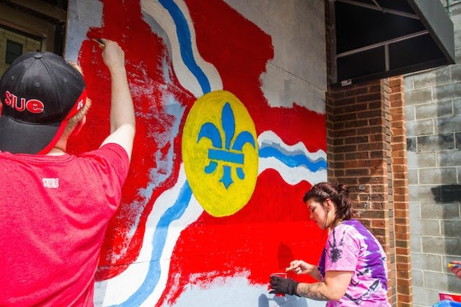 Artists Mark Ostroot and Nicole High paint at Fro Yo. - COURTESY OF PAINTING FOR PEACE IN FERGUSON, A CHILDREN'S BOOK