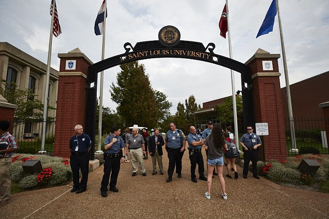 Police at St. Louis University posted at campus entrances during Sunday's protest march. - PHOTO BY THEO WELLING