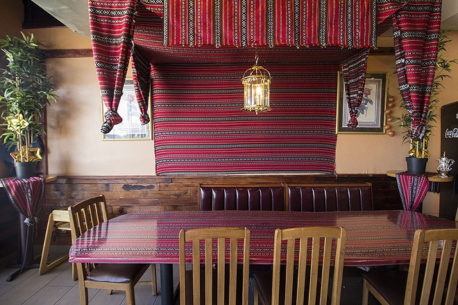 Red tapestries adorn the dining room. - PHOTO BY MABEL SUEN