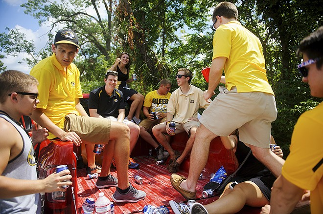 Fans tailgate in the back of a pickup truck. - NICK SCHNELLE/COLUMBIA TRIBUNE