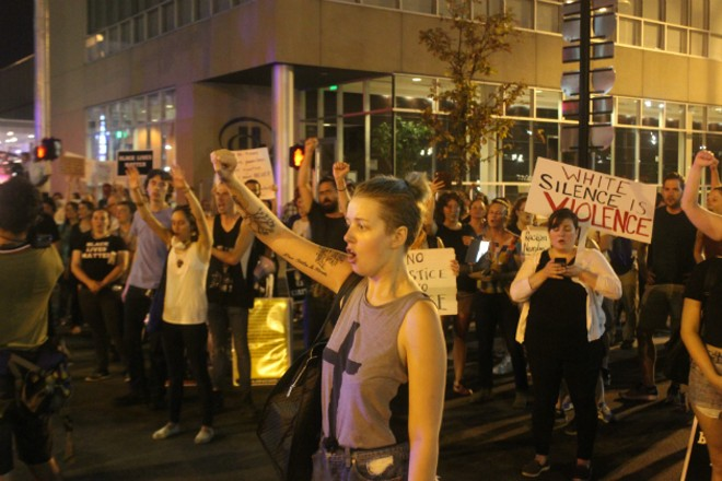 Several hundred people marched on Thursday from Kiener Plaza to Busch Stadium. - PHOTO BY DOYLE MURPHY