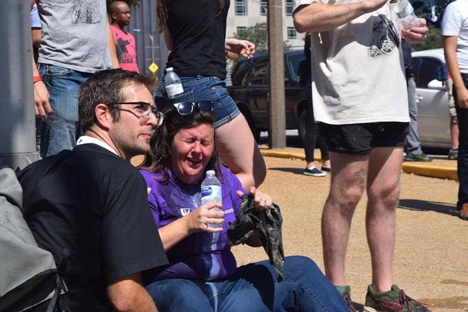 Alison Dreith reacts after being pepper-sprayed. - PHOTO COURTESY OF ZACH STAFFORD
