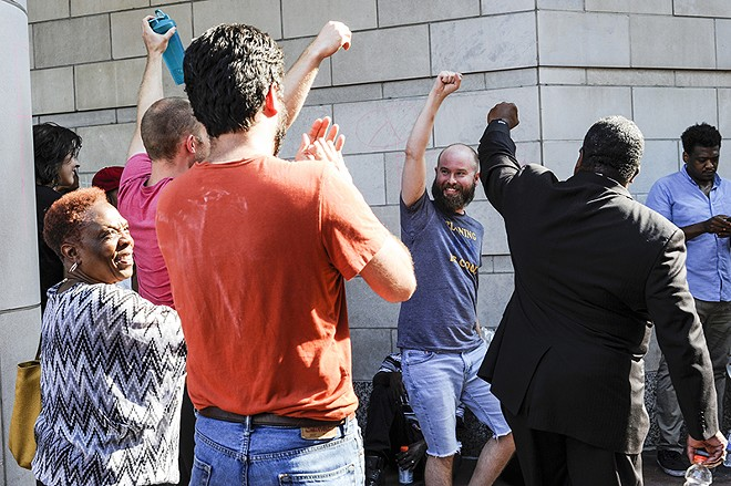 Zachary Becker, center, was one of the last people to be released following the Galleria arrests. - PHOTO BY KELLY GLUECK