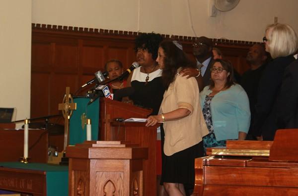 Reverend Cassandra Gould spoke alongside Rabbi Susan Talve at today's press conference at St. Peters AME Church. - PHOTO BY ELIZABETH SEMKO.