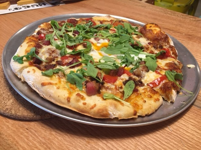 """The """"Farm Boy"""" pizza is topped with arugula, roasted red pepper, bacon and an egg. - PHOTO BY SARAH FENSKE"""