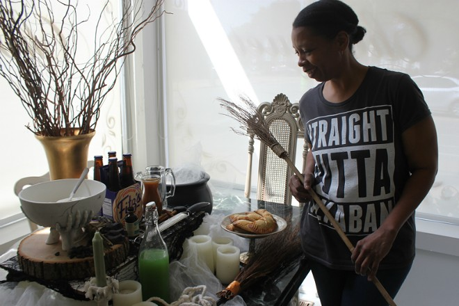 """Faure's """"Straight Outta Azkaban"""" shirt fits in with her table of Harry Potter goodies. - ALLISON BABKA"""