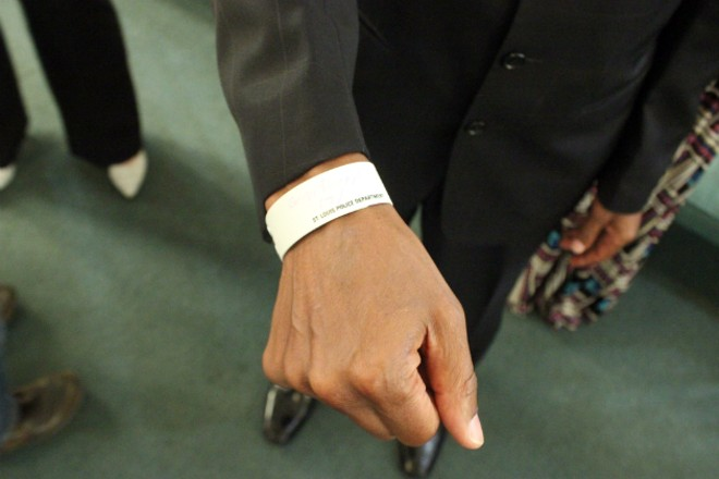 The Rev. Darryl Gray plans to continue to wear the ID bracelet from his arrest. - PHOTO BY DOYLE MURPHY