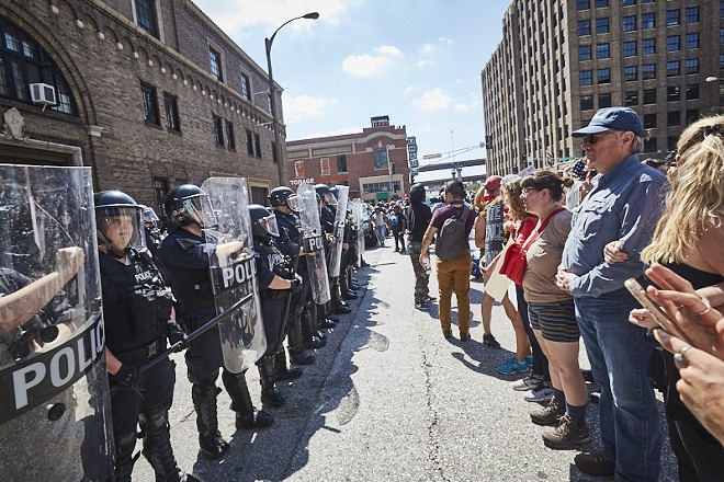 Protesters and police face off in downtown St. Louis on September 15, 2017, the day a former cop was acquitted of murder. - PHOTO BY THEO WELLING