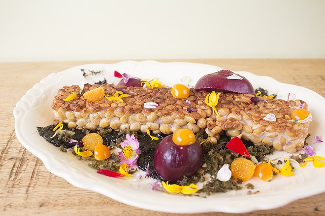 Tempeh comes with pickled beets, honey, black tahini, fermented kale and golden berry. - MABEL SUEN