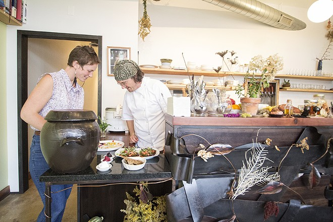 Chef-owner William Pauley examines on order. - MABEL SUEN