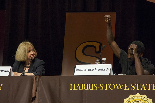 State Rep. Bruce Franks raises his fist during an audience-led protest chant Wednesday night. - DANNY WICENTOWKI