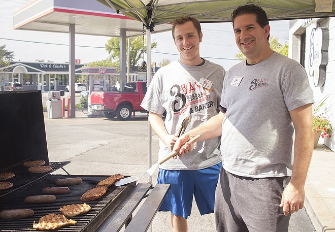 Pitmasters Tyler Barnes and Brian Montan work their magic. - MABEL SUEN