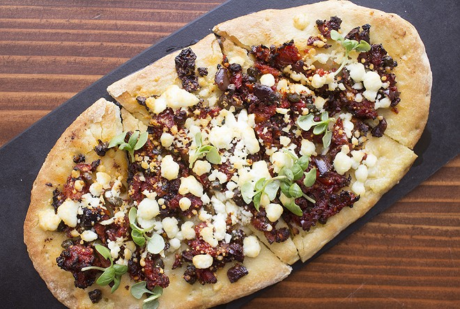 The sundried tomato flatbread is topped with oregano, feta and extra virgin olive oil. - MABEL SUEN
