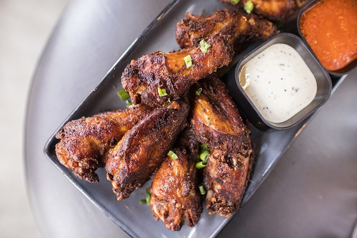 Smoked wings, served with Calabrian buffalo sauce and black-peppercorn ranch.