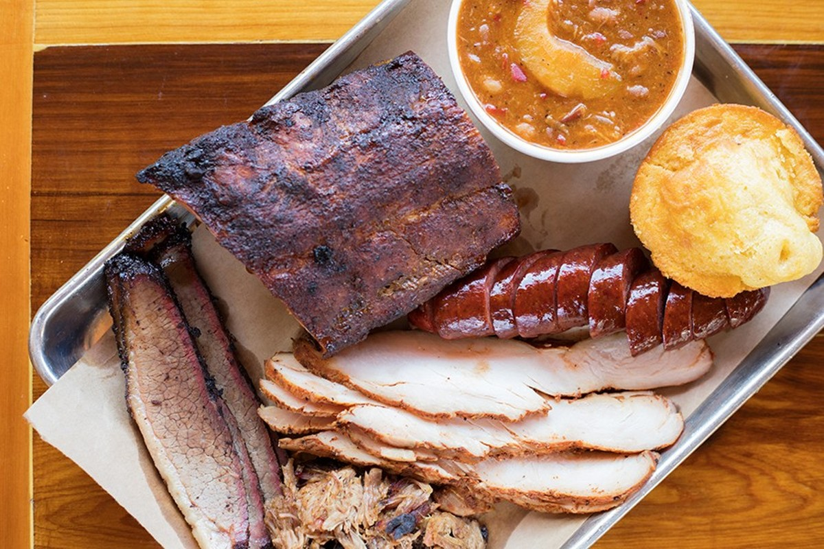 Honey Pit's sampler platter includes brisket, pulled pork, turkey, a sausage link and ribs.