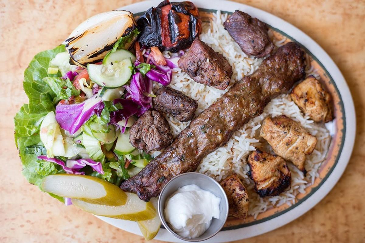 Majeed's mixed-grill entree includes beef kefta, shish tawuk and shish kabob, along with rice and salad.
