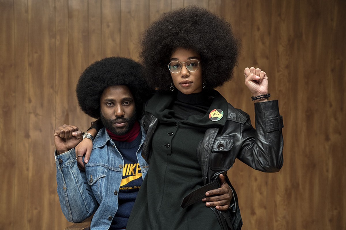 Ron Stallworth (John David Washington) pretends to be a KKK fan while also courting Black Power activist Patrice (Laura Harrier).