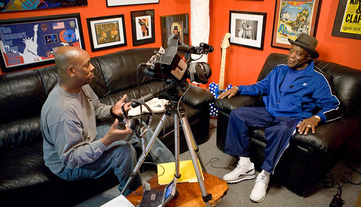 Art Holliday interviewing Buddy Guy.