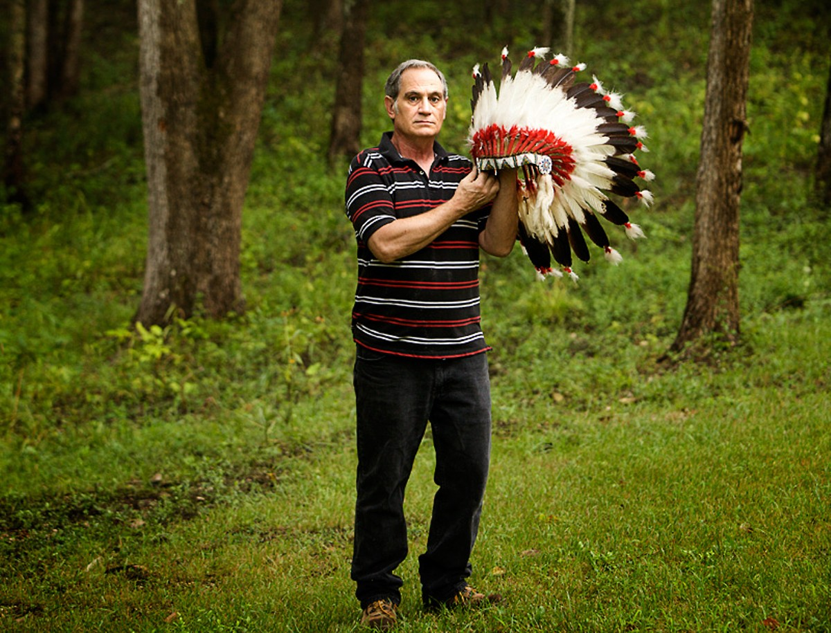 Kevin Airis shows off one of the two eagle-feather headdresses the Science Center returned to him in 2007.