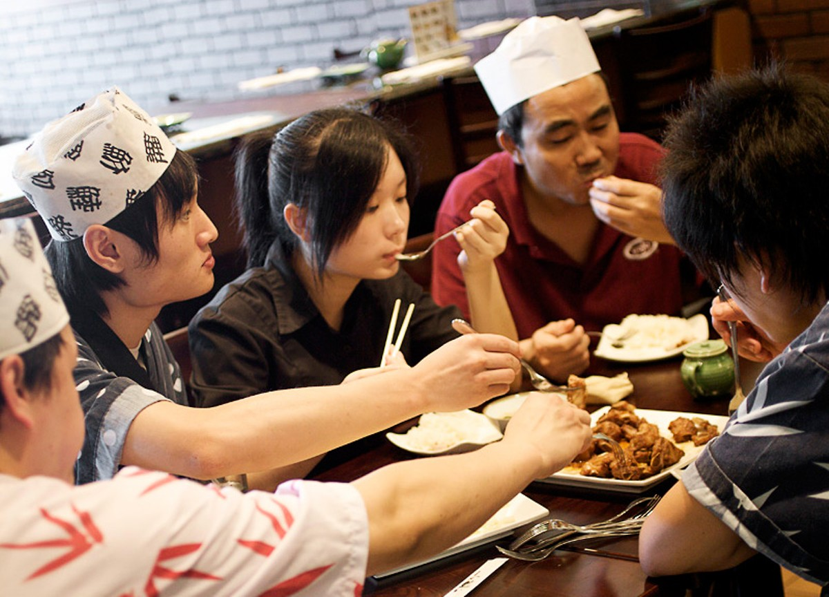 The owners and staf sit down for lunch after the customers have gone. See more photos from Sushi Ai.