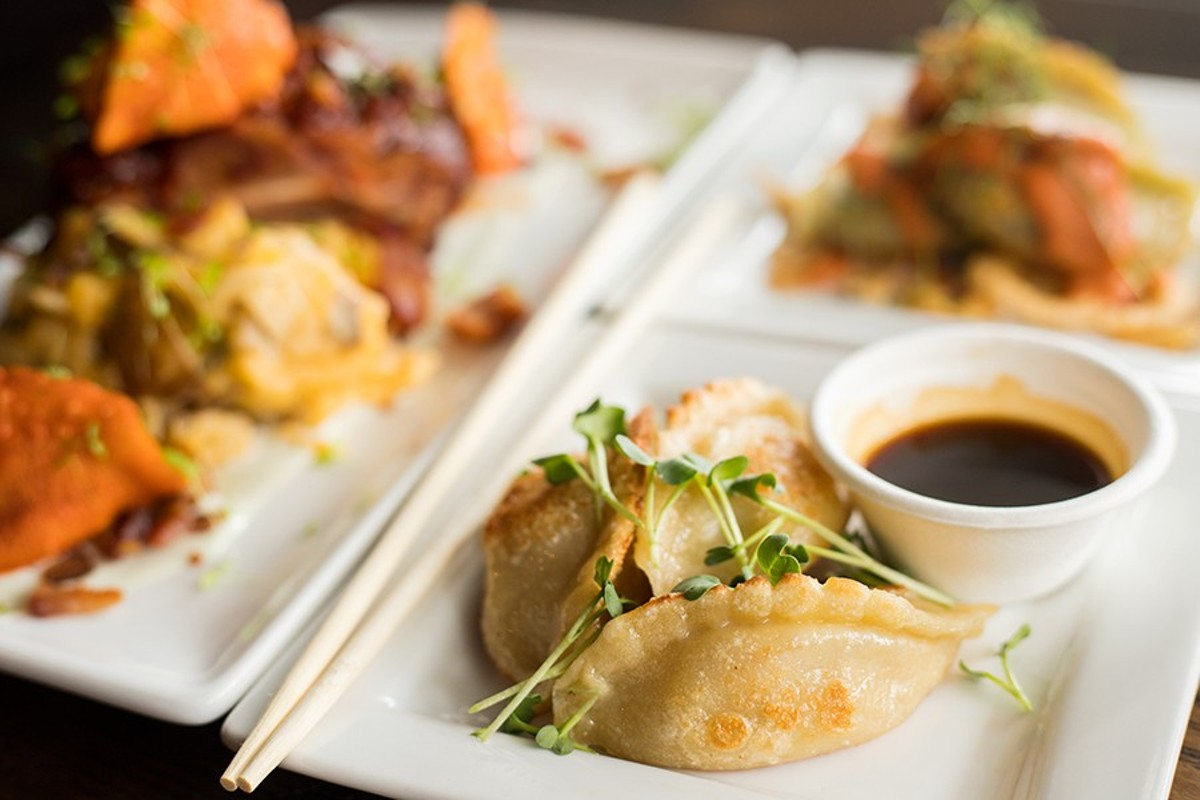 Traditional potstickers are stuffed with ginger pork and cabbage, then served with citrus ponzu glaze and daikon microgreens.