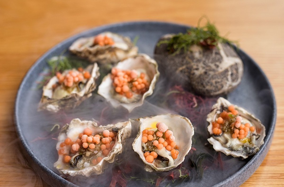 """Oysters and Pearls,"" served in a swirl of liquid nitrogen, are Yellowbelly's most awe-inspiring dish."