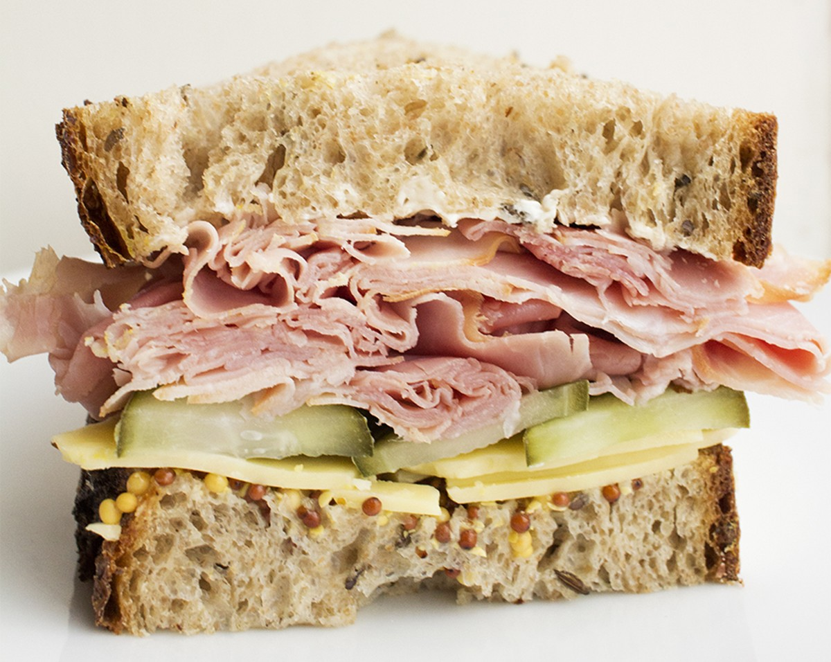 The interplay of caraway and dill elevate this ham and cheese on rye to the stratosphere.