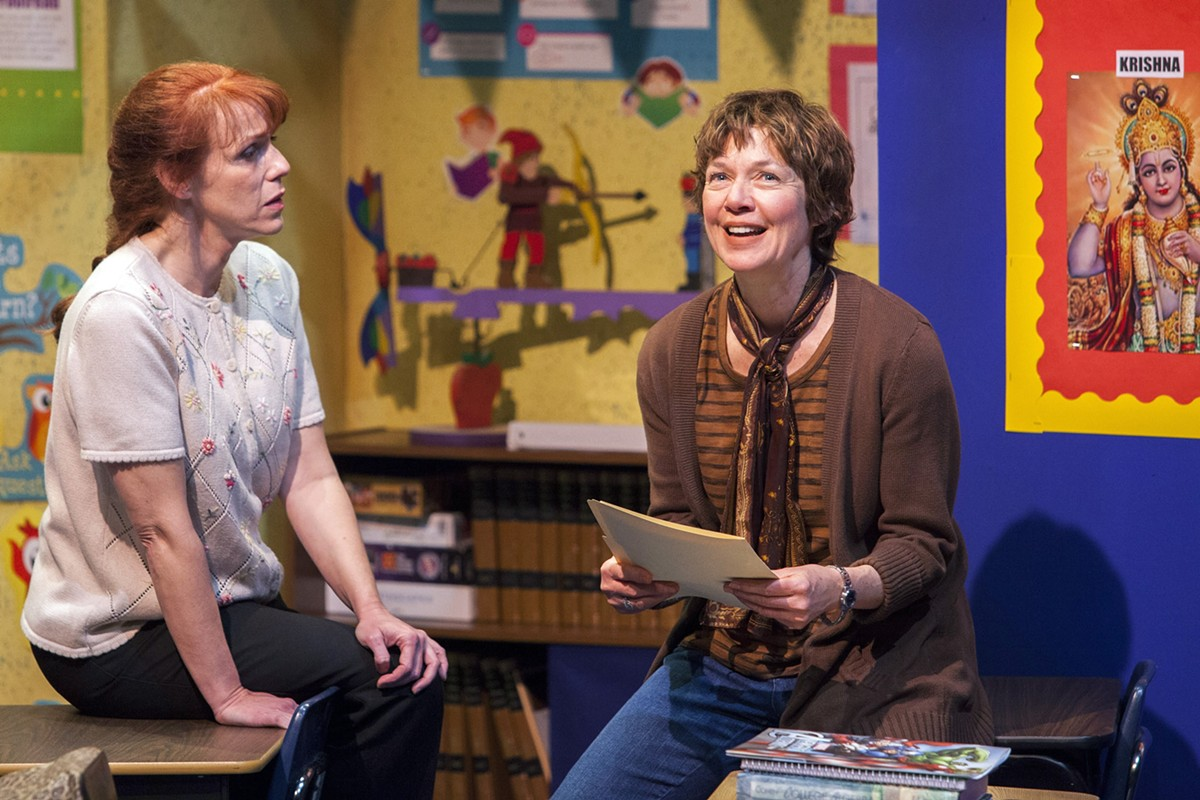 Heather (Laurie McConnell) and Corryn (Elizabeth Ann Townsend) discuss Gidion's problems.
