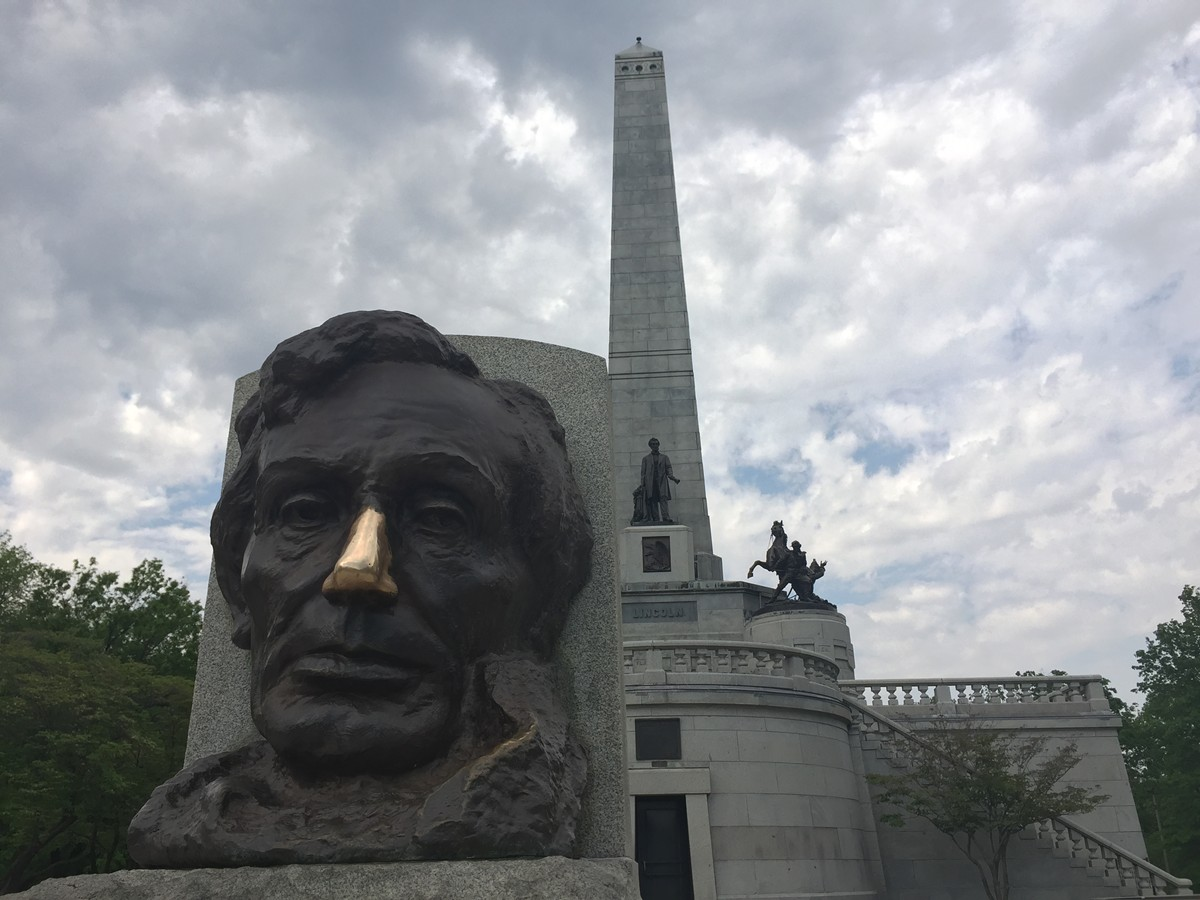 The grubby hands of thousands of tourists have polished Abraham Lincoln's nose to a shine.